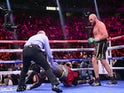 Tyson Fury lands the decisive blow in stopping Deontay Wilder in the 11th round on October 9, 2021.