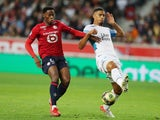 Olympique de Marseille's William Saliba in action with Lille's Jonathan David in October 2021