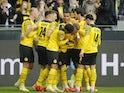 Borussia Dortmund's Marco Reus celebrates scoring their first goal with teammates on October 16, 2021