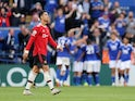 Manchester United's Cristiano Ronaldo looks on as Leicester City players celebrate a goal on October 16, 2021