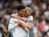 Fulham's Antonee Robinson celebrates scoring their fourth goal with Tim Ream on October 16, 2021