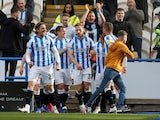 Huddersfield Town's Tom Lees celebrates scoring their first goal with teammates on October 16, 2021
