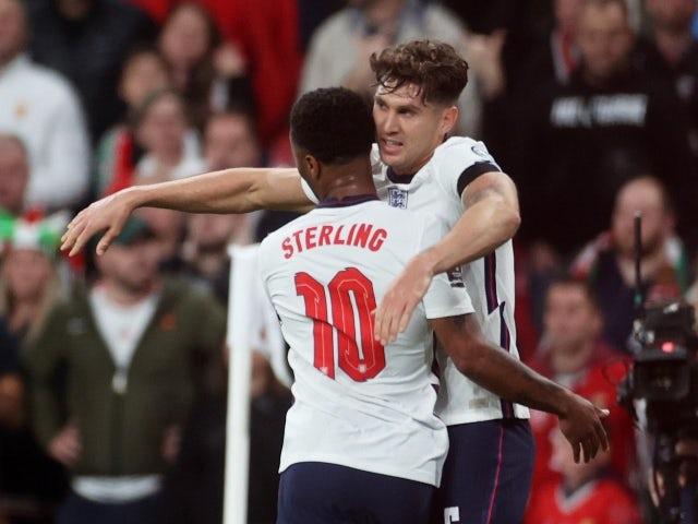 England's John Stones celebrates with Raheem Sterling on October 12, 2021