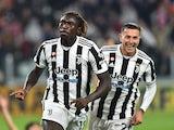 Juventus' Moise Kean celebrates scoring their first goal with Federico Bernardeschi on October 17, 2021