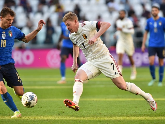 Belgium's Kevin De Bruyne in action with Italy's Nicolo Barella on October 10, 2021