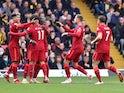 Liverpool's Sadio Mane celebrates scoring their first goal with teammates on October 16, 2021