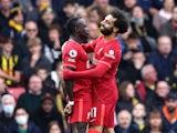 Liverpool's Sadio Mane celebrates scoring their first goal with Mohamed Salah on October 16, 2021