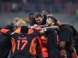 AC Milan's Koray Gunter celebrates scoring their third goal with teammates on October 16, 2021