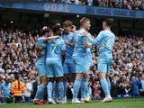 Manchester City's Bernardo Silva celebrates scoring their first goal with teammates on October 16, 2021