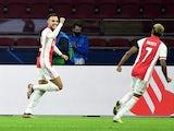 Ajax's Noussair Mazraoui celebrates with David Neres on November 25, 2020