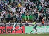 Palmeiras' Raphael Veiga celebrates scoring their first goal with Rony and Luiz Adriano on October 17, 2021