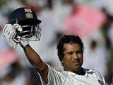 India's Sachin Tendulkar celebrates becoming the highest-ever Test run scorer on October 17, 2008.