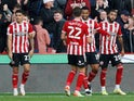 Sheffield United's Lys Mousset celebrates scoring their first goal with teammates on October 16, 2021