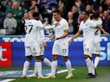 Swansea City's Joel Piroe celebrates scoring their second goal with teammates on October 17, 2021