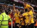 Wolverhampton Wanderers' Ruben Neves celebrates scoring their third goal with teammates on October 16, 2021