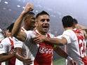Ajax's Dusan Tadic celebrates after they score their first goal on October 19, 2021