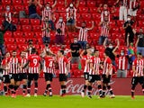 Athletic Bilbao players celebrate scoring against Barcelona on August 21, 2021