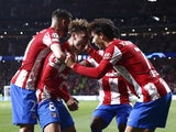 Atletico Madrid's Antoine Griezmann celebrates scoring their second goal with teammates on October 19, 2021