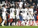Besiktas' Cyle Larin celebrates scoring their first goal with teammates on October 19, 2021