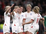 England's Bethany Mead celebrates scoring their third goal with teammates on October 23, 2021