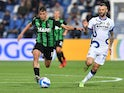 Sassuolo's Filip Duricic in action with Inter Milan's Marcelo Brozovic on October 2, 2021