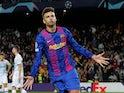 Gerard Pique celebrates scoring for Barcelona in October 2021