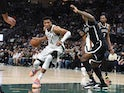 Milwaukee Bucks forward Giannis Antetokounmpo drives to the basket in the second half against the Brooklyn Nets on October 20, 2021