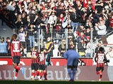 Bayer Leverkusen's Patrik Schick celebrates scoring their first goal with teammates on October 24, 2021