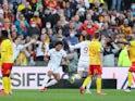 Metz's Nicolas de Preville celebrates scoring their first goal with teammates on October 24, 2021