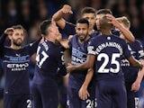 Manchester City's Riyad Mahrez celebrates scoring their fourth goal with teammates on October 23, 2021