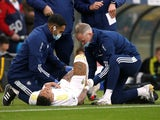 Leeds United's Raphinha receives medical attention after sustaining an injury on October 23, 2021
