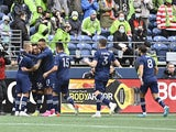 Sporting Kansas City celebrate after a goal was scored against the Seattle Sounders by Sporting Kansas City midfielder Remi Walter (54) during the first half at Lumen Field on October 23, 2021