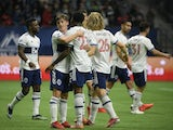 The Vancouver Whitecaps celebrates midfielder Ryan Gauld (25) goal against Sporting Kansas City goalkeeper Tim Melia (29) during the first half at BC Place on October 17, 2021
