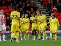 Brentford's Ivan Toney celebrates scoring their second goal against Stoke City with teammates on October 27, 2021