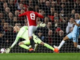 Manchester United's Juan Mata scores past Manchester City's Willy Caballero on October 26, 2016
