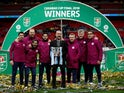 Manchester City manager Pep Guardiola and his coaching staff celebrate with the EFL Cup on February 25, 2018