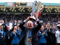 Rangers manager Walter Smith holds aloft the Scottish Premiership title on May 15, 2011