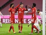 Bayern Munich's Leroy Sane, Robert Lewandowski and Alphonso Davies celebrate a goal which is later disallowed on January 3, 2021