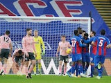 Crystal Palace's Jeffrey Schlupp celebrates scoring their first goal with teammates against Sheffield United on January 2, 2021