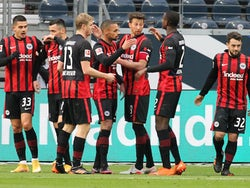 Eintracht Frankfurt's Amin Younes celebrates scoring their first goal with teammates on January 2, 2021