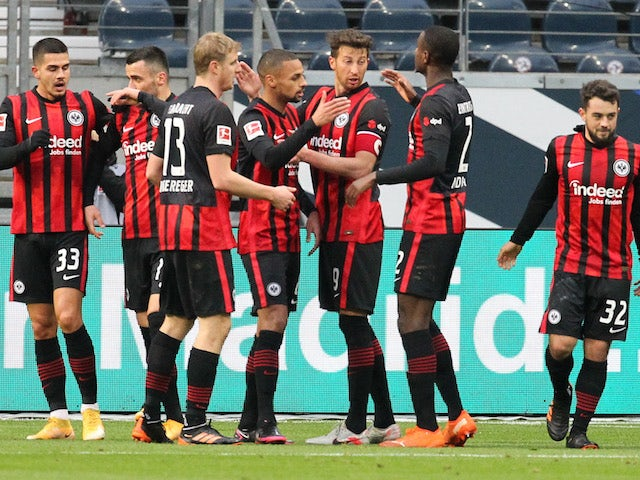 Eintracht Frankfurt's Amin Younes celebrates scoring their first goal with teammates on January 2, 2021