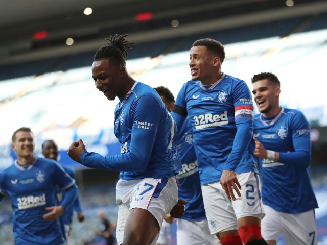 Rangers players celebrate after Celtic's Callum McGregor scores an own goal in the Scottish Premiership on January 2, 2021
