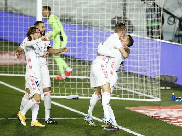 Real Madrid's Lucas Vazquez celebrates scoring their first goal with teammates against Celta Vigo on January 2, 2021