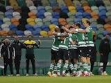 Sporting Lisbon's Pedro Goncalves celebrates scoring their first goal with teammates