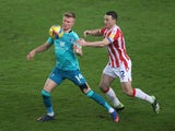 Stoke City's James Chester in action with Bournemouth's Sam Surridge in the Championship on January 2, 2021